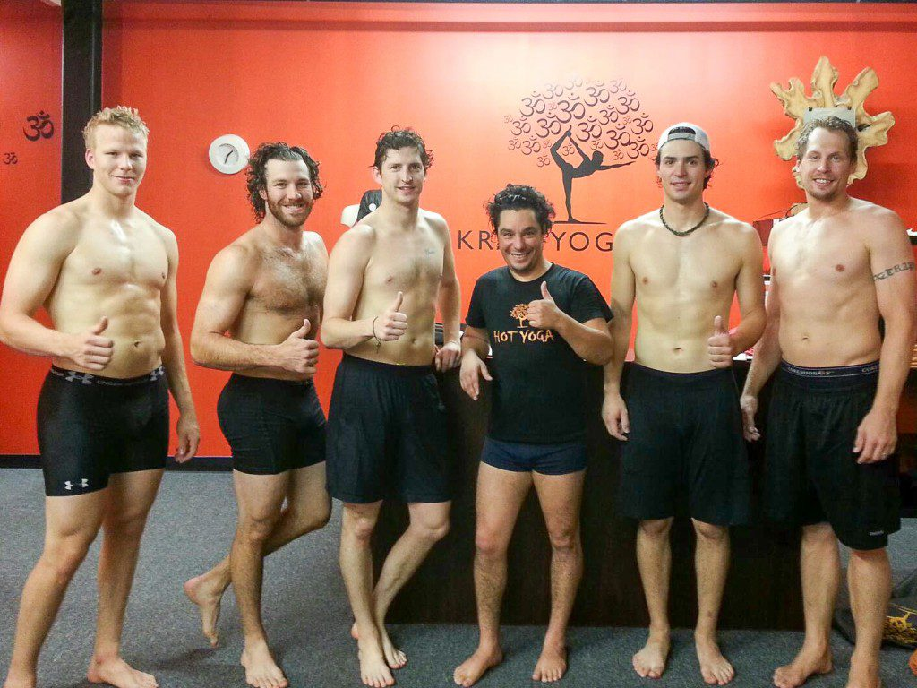 Lars Eller, Brandon Prust, Colby Armstrong, instructor Alain Robin, Carey Price, Travis Moen (Photo by Bikram Yoga DIX30)