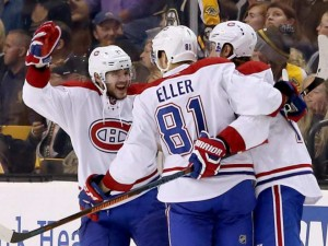 Galchenyuk, Eller, Semin Celebrate a goal (Photo by: MARY SCHWALM / AP)