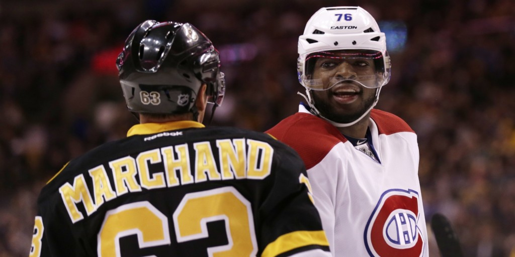 Montreal Canadiens defenseman P.K. Subban (76) exchanges glances with Boston Bruins left wing Brad Marchand (63) during the second period of an NHL hockey game, Monday, March 24, 2014, in Boston. (AP Photo/Charles Krupa)